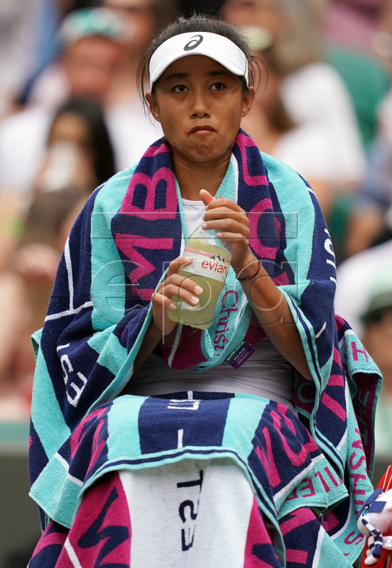 Shuai Zhang of China plays Simona Halep of Romania in their quarter final match during the Wimbledon Championships at the All England Lawn Tennis Club, in London, Britain, 09 July 2019. EPA-EFE/WILL OLIVER EDITORIAL USE ONLY/NO COMMERCIAL SALES