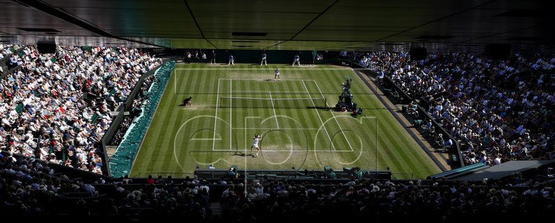 Johanna Konta (front) of Britain in action against Barbora Strycova of the Czech Republic during their quarter final match for the Wimbledon Championships at the All England Lawn Tennis Club, in London, Britain, 09 July 2019. EPA-EFE/NIC BOTHMA EDITORIAL USE ONLY/NO COMMERCIAL SALES