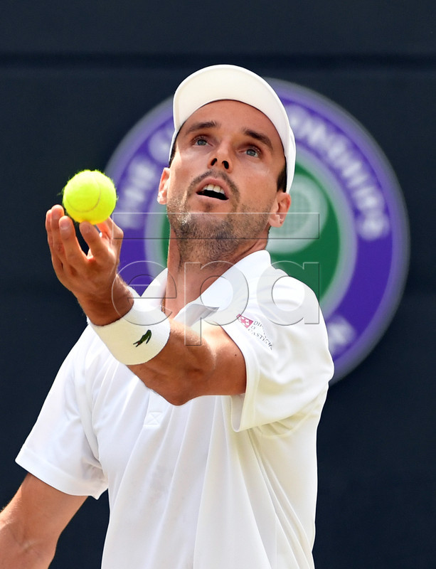 Roberto Bautista Agut of Spain serves to Guido Pella of Argentina in their quarter final match during the Wimbledon Championships at the All England Lawn Tennis Club, in London, Britain, 10 July 2019. EPA-EFE/FACUNDO ARRIZABALAGA EDITORIAL USE ONLY/NO COMMERCIAL SALES