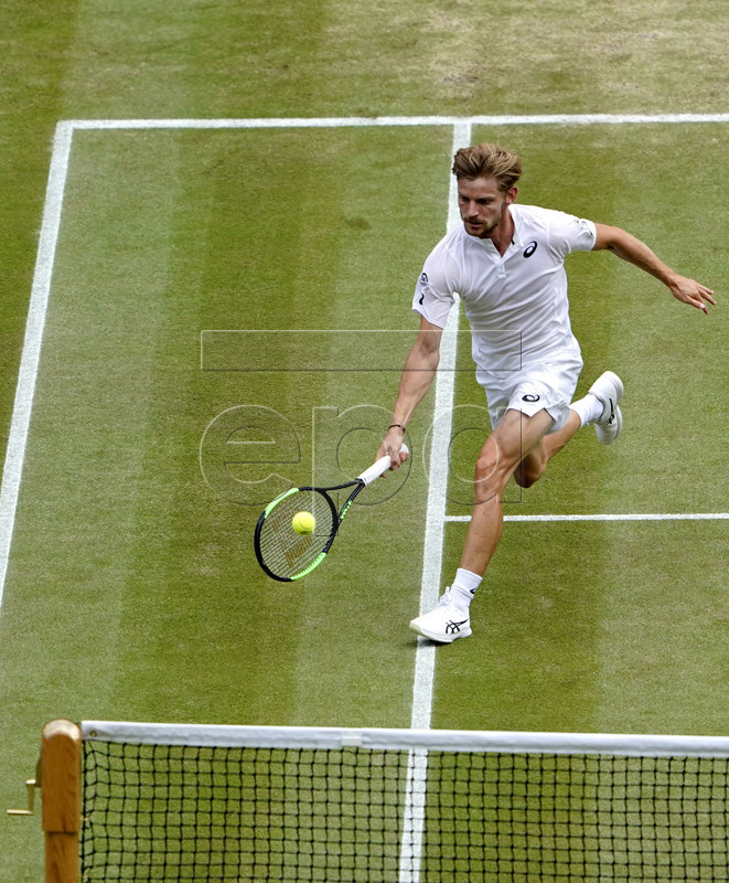 David Goffin of Belgium in action against Novak Djokovic of Serbia during their quarter final match for the Wimbledon Championships at the All England Lawn Tennis Club, in London, Britain, 10 July 2019. EPA-EFE/ANDY RAIN EDITORIAL USE ONLY/NO COMMERCIAL SALES