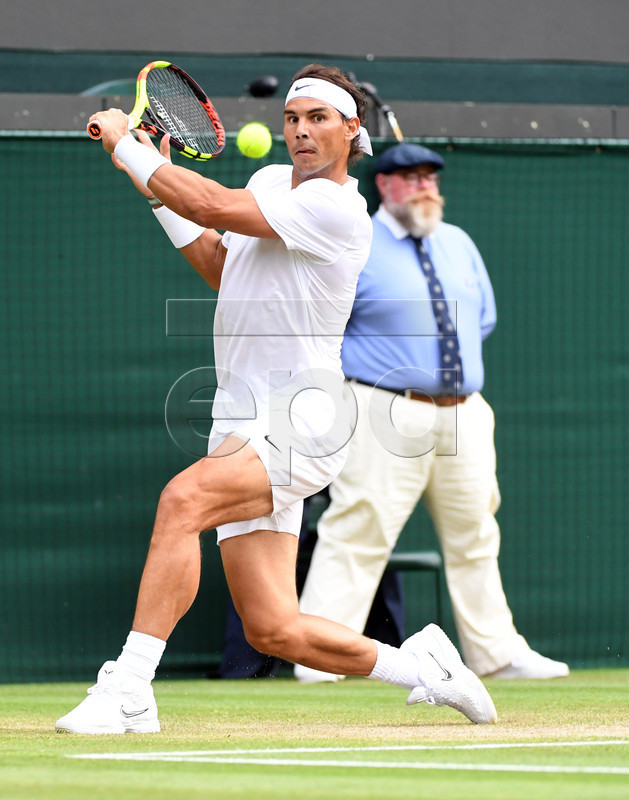 Rafael Nadal of Spain returns to Sam Querrey of the US in their quarter final match during the Wimbledon Championships at the All England Lawn Tennis Club, in London, Britain, 10 July 2019. EPA-EFE/FACUNDO ARRIZABALAGA EDITORIAL USE ONLY/NO COMMERCIAL SALES