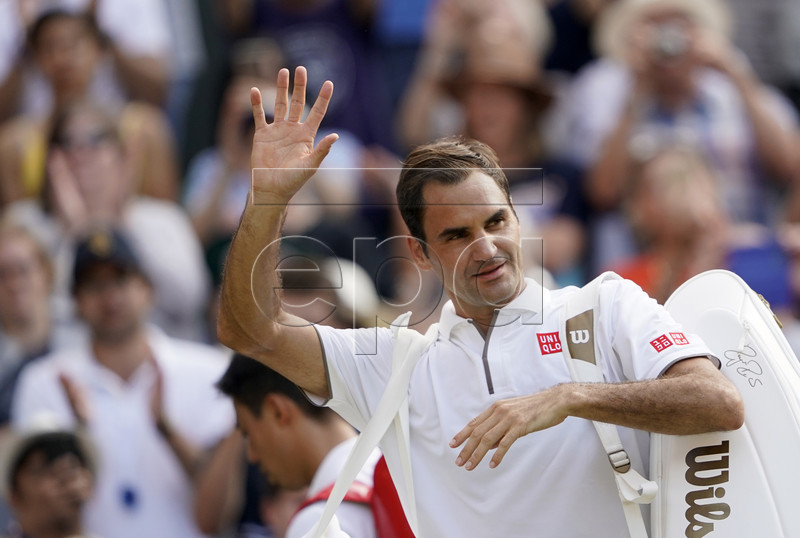 Roger Federer of Switzerland celebrates winning against Kei Nishikori of Japan during their quarter final match for the Wimbledon Championships at the All England Lawn Tennis Club, in London, Britain, 10 July 2019. EPA-EFE/NIC BOTHMA EDITORIAL USE ONLY/NO COMMERCIAL SALES