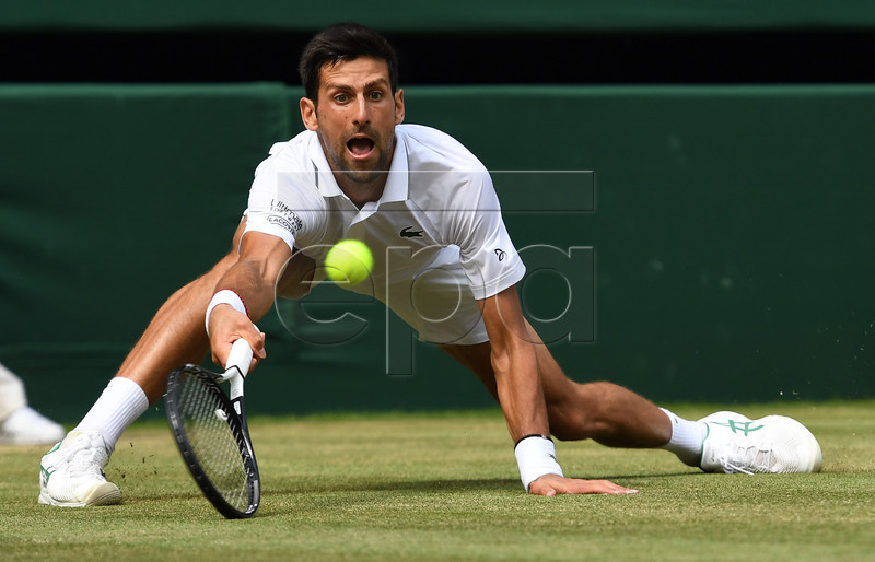 Novak Djokovic of Serbia returns to Roberto Bautista Agut of Spain in their semi final match during the Wimbledon Championships at the All England Lawn Tennis Club, in London, Britain, 12 July 2019. EPA-EFE/ANDY RAIN EDITORIAL USE ONLY/NO COMMERCIAL SALES