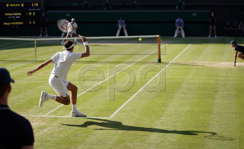 Roger Federer of Switzerland returns to Rafael Nadal of Spain in their semi final match during the Wimbledon Championships at the All England Lawn Tennis Club, in London, Britain, 12 July 2019. EPA-EFE/NIC BOTHMA EDITORIAL USE ONLY/NO COMMERCIAL SALES