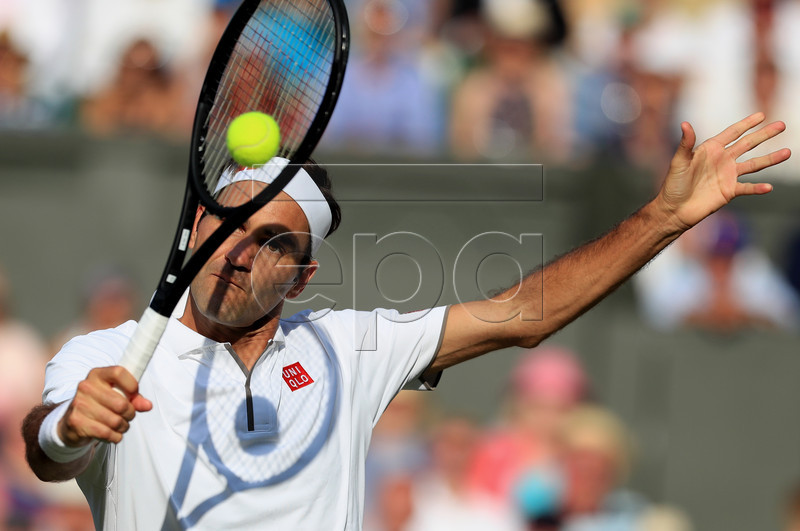 Roger Federer of Switzerland in action against Rafael Nadal of Spain during their semi final match for the Wimbledon Championships at the All England Lawn Tennis Club, in London, Britain, 12 July 2019. EPA-EFE/Mike Egerton / POOL EDITORIAL USE ONLY/NO COMMERCIAL SALES