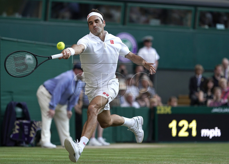 Roger Federer of Switzerland in action against Rafael Nadal of Spain during their semi final match for the Wimbledon Championships at the All England Lawn Tennis Club, in London, Britain, 12 July 2019. EPA-EFE/WILL OLIVER EDITORIAL USE ONLY/NO COMMERCIAL SALES