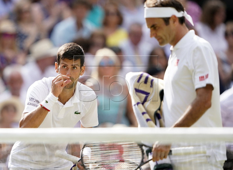 Novak Djokovic of Serbia argues a call as he plays Roger Federer of Switzerland in the men's final of the Wimbledon Championships at the All England Lawn Tennis Club, in London, Britain, 14 July 2019. EPA-EFE/NIC BOTHMA EDITORIAL USE ONLY/NO COMMERCIAL SALES