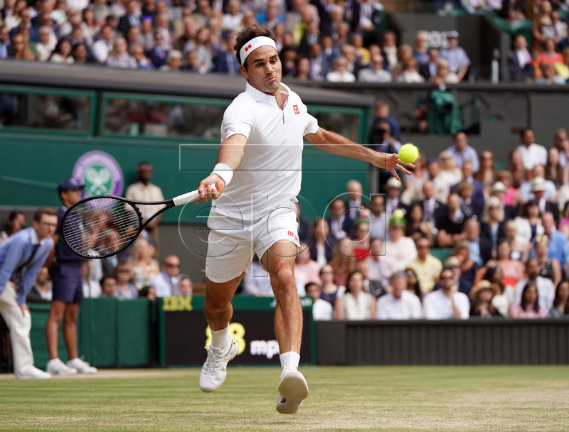 Roger Federer of Switzerland returns to Novak Djokovic of Serbia in the men's final of the Wimbledon Championships at the All England Lawn Tennis Club, in London, Britain, 14 July 2019. EPA-EFE/NIC BOTHMA EDITORIAL USE ONLY/NO COMMERCIAL SALES