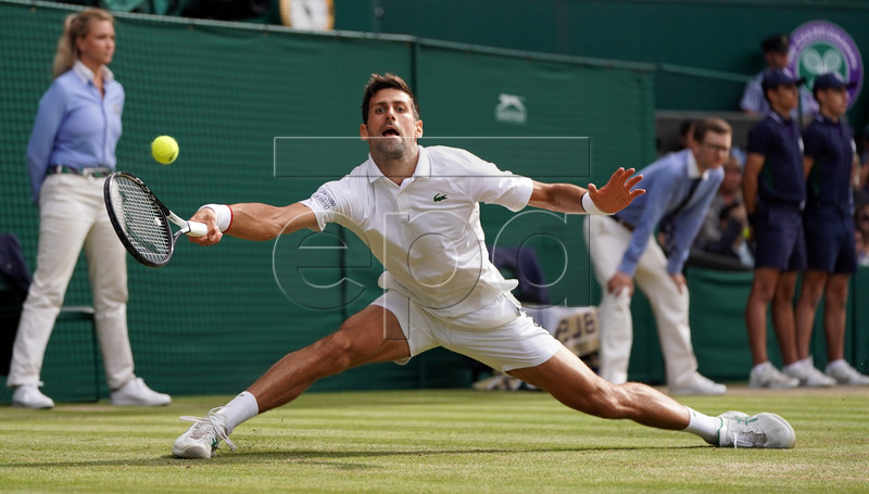 Novak Djokovic of Serbia plays Roger Federer of Switzerland in the men's final of the Wimbledon Championships at the All England Lawn Tennis Club, in London, Britain, 14 July 2019. EPA-EFE/NIC BOTHMA EDITORIAL USE ONLY/NO COMMERCIAL SALES
