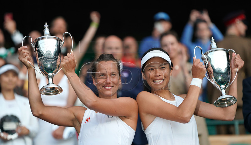 Su-Wei Hsieh of Taiwan and Barbora Strycova of Czech Republic celebrate with their trophies after winning against Gabriela Dabrowski of Canada and Yifan Xu of China during their Women's Doubles final match at the Wimbledon Championships at the All England Lawn Tennis Club, in London, Britain, 14 July 2019. EPA-EFE/NIC BOTHMA EDITORIAL USE ONLY/NO COMMERCIAL SALES