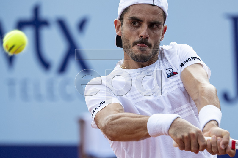 Thomas Fabbiano of Italy in action against Sandro Ehrat of Switzerland during a first round game at the Swiss Open tennis tournament in Gstaad, Switzerland, Monday, July 22, 2019.  EPA-EFE/PETER SCHNEIDER