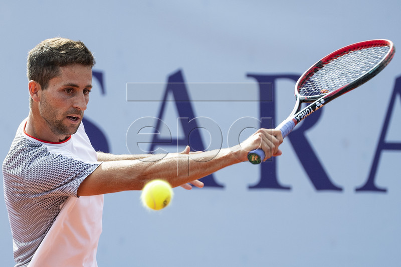 Sandro Ehrat of Switzerland in action against Thomas Fabbiano of Italy during a first round game at the Swiss Open tennis tournament in Gstaad, Switzerland, Monday, July 22, 2019.  EPA-EFE/PETER SCHNEIDER