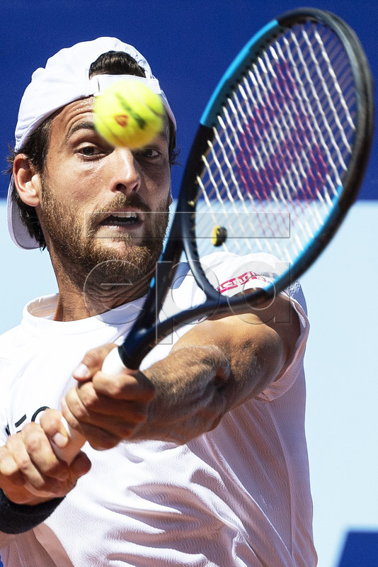Joao Sousa of Portugal in action against Steve Darcis of Belgium during their first round match of the Swiss Open tennis tournament in Gstaad, Switzerland, 23 July 2019. EPA-EFE/PETER SCHNEIDER
